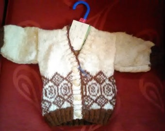 Hand knitted cardigan,  knitted with home spun wool, to fit a child aged 0-3 months old