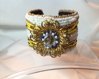 Yellow Shibori silk and filigree aluminum cuff bracelet with seed beads and bicones