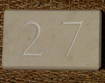 Plate of street number carved ivory Tavel stone