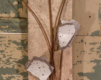 Broken pottery gray floral wall hanging with vintage hardware and piano wires.