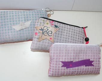 Sets of 3 zippered pouches padded and lined in printed satin fabric on bottom star