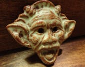 Ceramic button.  Satyr.  Handmade stoneware.  Brown glaze.