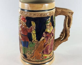 Ceramic Hunting Beer Stein with man and woman with dog 16 Ounce
