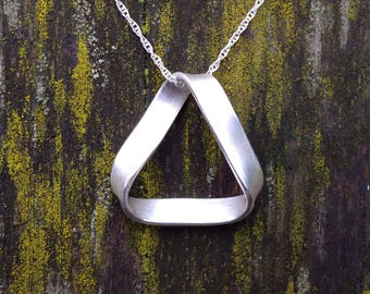 Triangle Möbius strip / twist necklace in fine silver. Handmade in UK
