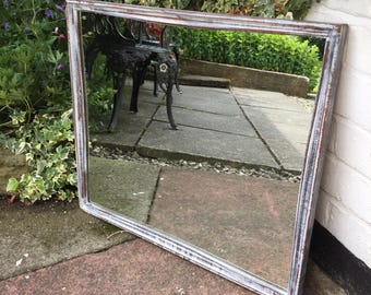 Lovely shabby Chic mirror with distressed frame.