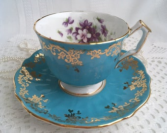 Aynsley Bone China Tea Cup and Saucer, Turquoise Blue with Purple and White Violets, Gold Gilding and Trim