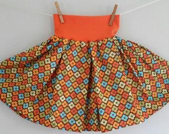 The skirt that turns! Orange flowers / orange