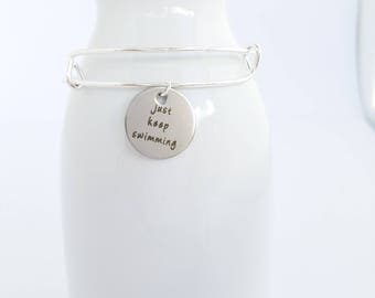 Just keep swimming silver color charm on a silver plated bangle bracelet -  inspirational quote -  fight - challenge - dream - inspire