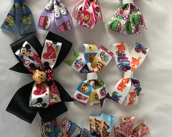 Varity of hair bows , character hairbows , girly accessories , small hair bows