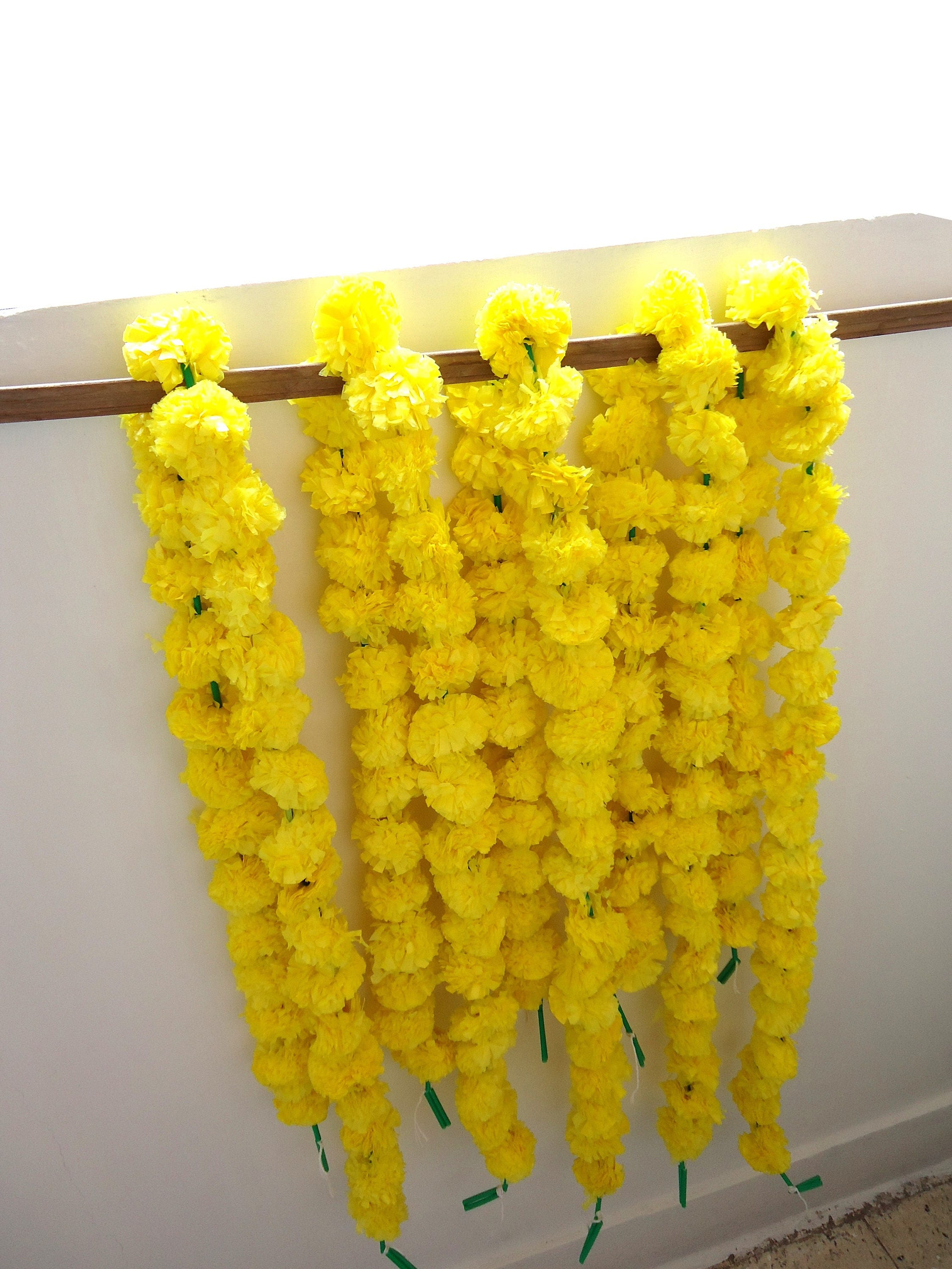 Yellow marigold flowers string artificial marigold for Artificial flowers for home decoration india