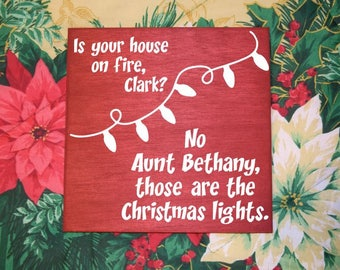 Is your house on fire, Clark? No Aunt Bethany, those are the Christmas Lights - Clark Griswald. National Lampoon's Christmas Vacation Sign