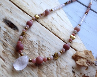 Gorgeous gemstone necklace featuring Rose Quartz, Rhodochrosite and Golden Hematite. Hand-strung with beautiful semi-precious beads.