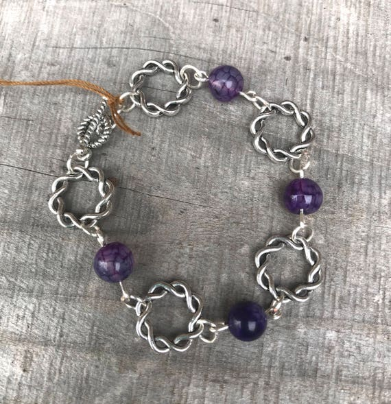 Amethyst and twisted silver hoops-link bracelet-silver wit toggle clasp