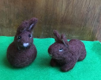 Cute Needle-Felted Easter Bunny Sitting Up Or Lying Down In Dark Brown, White Tail And Black Bead Eyes