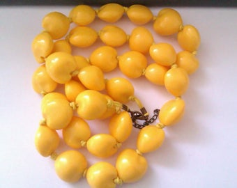 yellow heart shaped knotted bead necklace