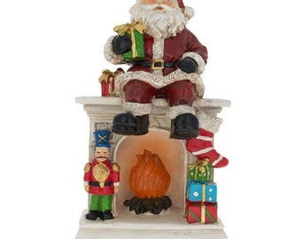 "7.75"" Santa Sitting on a Fireplace LED Lights Figurine"