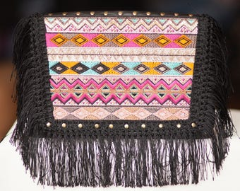 Clutch handbag with embroidery and fringe