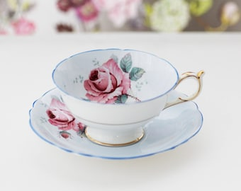 Beautiful Paragon England pale Blue teacup and saucer, gold gilt and blue rim, featuring a pink Cabbage Rose, Double Warrant stamp on bottom