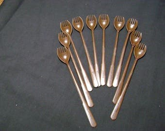 Tupperware vintage set of 10 brown long handled forks. 10.50 for all plus flat rate shipping of 7.20
