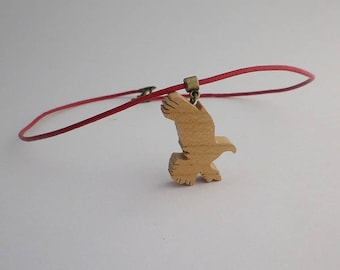 Eagle flying in cherry wood and red leather pendant