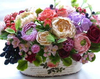 A composition with flowers of polymer clay.