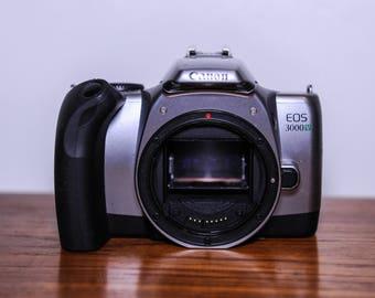 Canon EOS 3000v SLR 35mm film camera body only - 20 pound bin - student camera #410