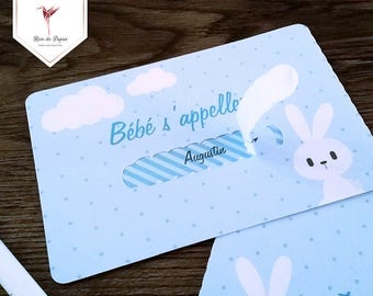 Detachable tab card to reveal baby's first name