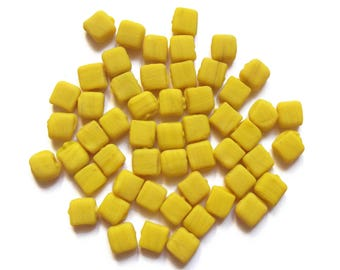 50 square yellow glass beads approximately 6 mm