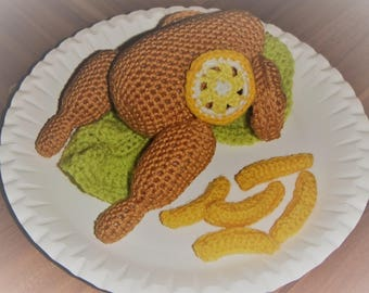 Self-crocheted chicken with French fries and salad
