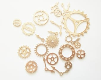 25g Of Rose Gold Coloured Cogs And Clock Parts. 25 Grams Random Mix.