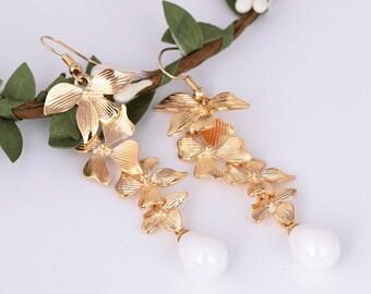 Beautiful Orchid golden drop earrings