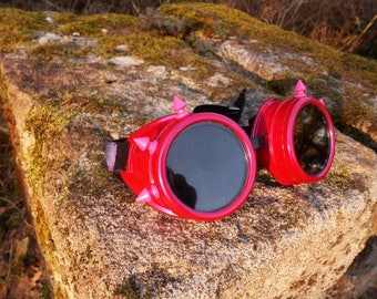 Pink steampunk goggles