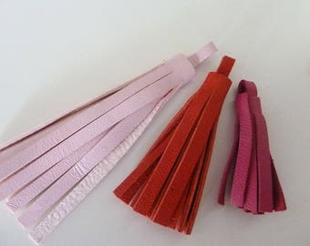 set of 3 red and pink leather tassels