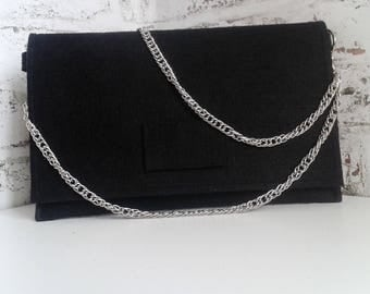 clutch hand bag black and silver chain.