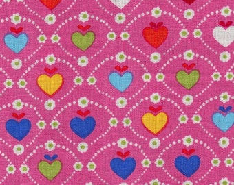 Little multicoloured hearts burst on pink background
