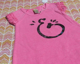 Neon pink cotton tee dress with ruffled hem and sleeves with Silver foil Ampersand