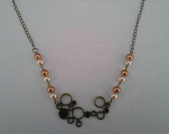 bronze necklace and pearl beads