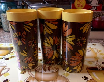 Thermo Serv Plastic / yellow / orange /brown flowers tumblers