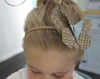 Check butterfly headband