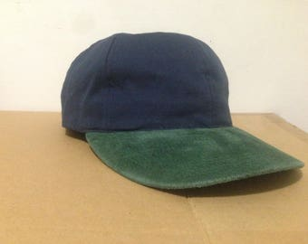 Navy blue cotton cap with green suede brim