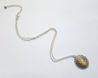 Necklace with gold tone cameo cabochon