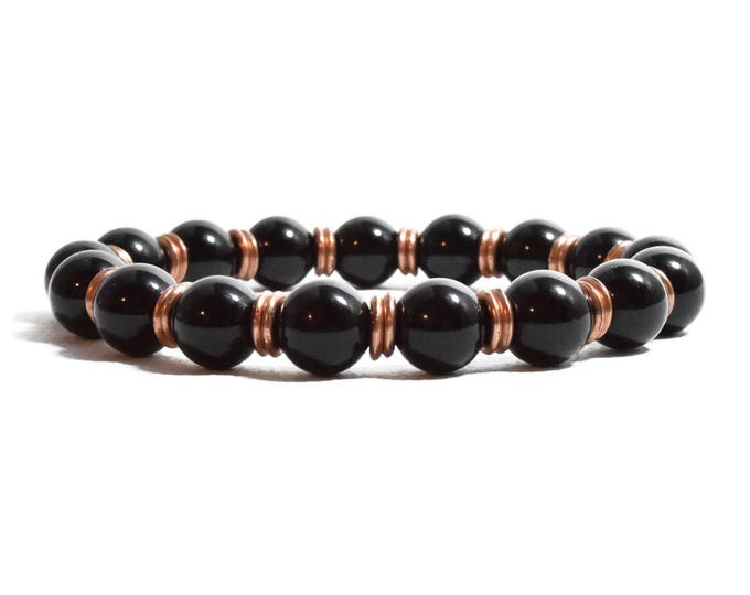 Women's Beaded Bracelet with Black Onyx and Copper tone beads separators.