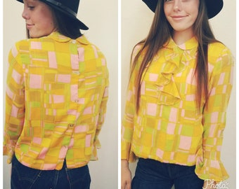 60s Vintage Yellow graphic blouse. Ruffles. Size Small.