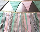 Two garlands: one flags and a lace and fabrics