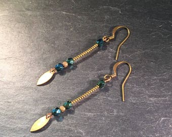 Long earrings with green beads.