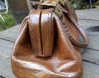 Brown old leather hand bag