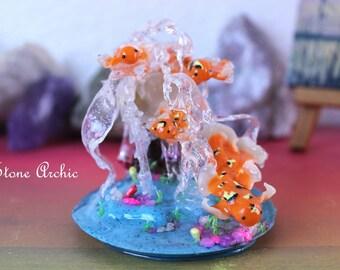 Fish in water sculpture