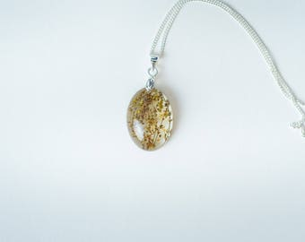 Hand picked, and dried Wildflower oval necklace.