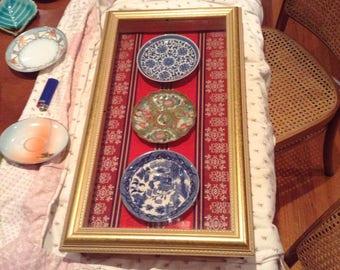 Framed porcelain plates