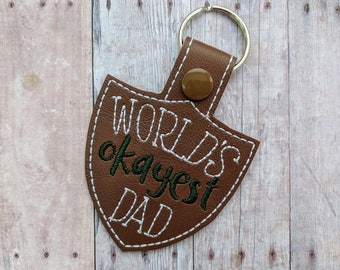 World's Okayest Dad Key Chain, Brown or Black Vinyl With Embroidery, Choice of Key Ring or Swivel Clip With Snap, Funny Fathers Day Gift